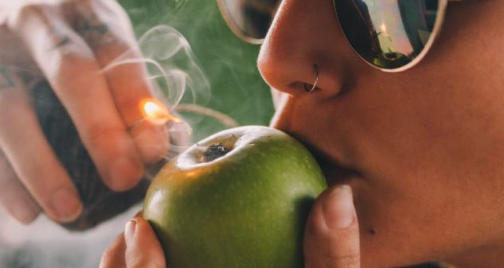 Smoking on an apple pipe