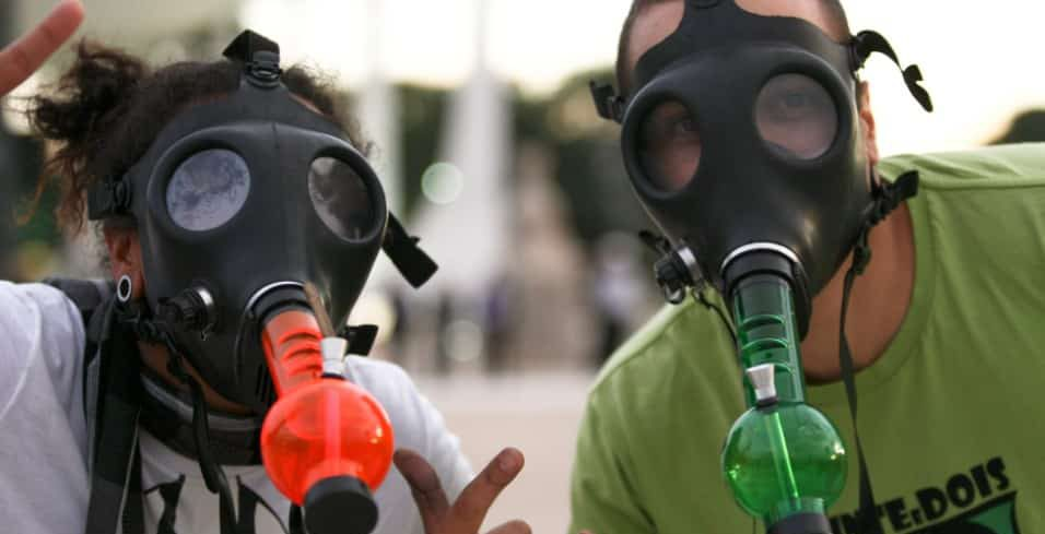 Two men with gas mask bong